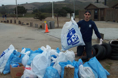 Many bags of trash are aggregated for pickup after Coastal Cleanup Day at San Gregorio State Beach.